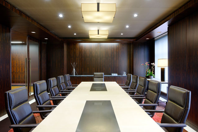 Ziricote wood paneled conference room with parchment and metal custom conference table