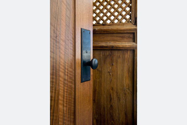 hand hewn wood door with special hardware and antique wood screen