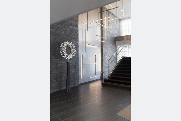 residential lobby stair art light feature