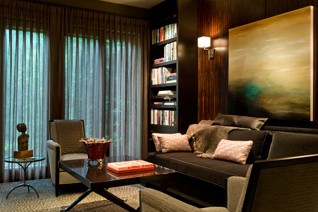 Wood paneling Den with soft seating and bookcase