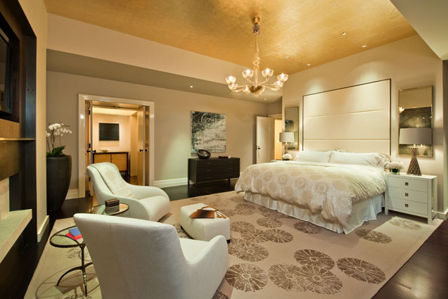 Master bedroom with gold leaf vaulted ceiling, chandelier and soft sitting area